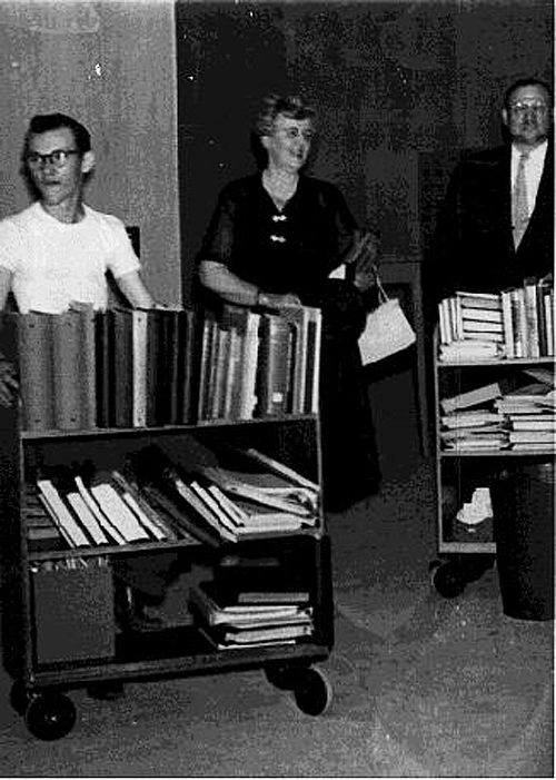 Librarian Mary Gillham supervised moving the library's holdings to the new building.